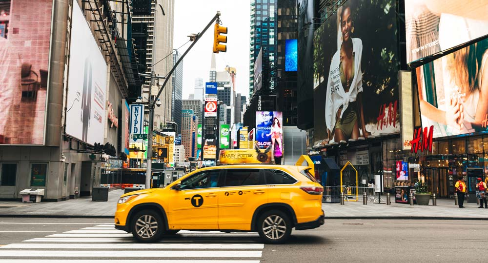 Taxi driving through Times Square