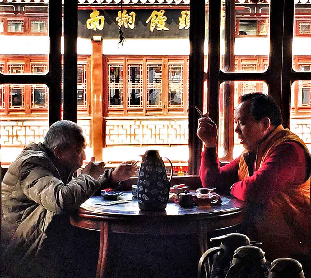Two locals in china eat food and drinking tea cost of travel in china