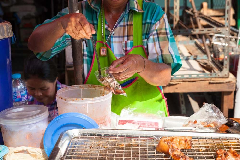 Thai local serving food at Wang Lang Market