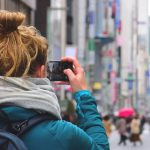 Taking photographs of a street in Tokyo, Japan